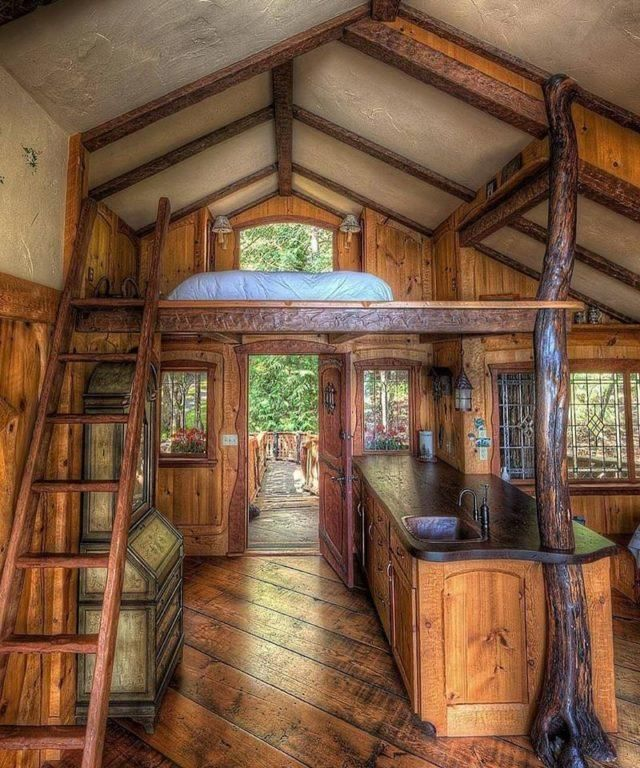 With two bedrooms a kitchen and bathroom this treehouse is a perfect lofty retreat. Built as family guesthouse in the Swiss chalet style its ramp is supported by salvaged Madrona logs with a bench 1/2 way up. Has running water sleeps four people restored leaded glass windows and many other unique featuresWhat do you think? TreeHouseWorkshop