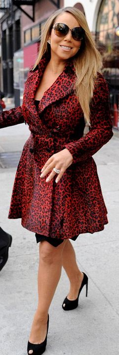 Who made  Mariah Carey's red animal print coat that she wore in New York?  Lucia Cunha
