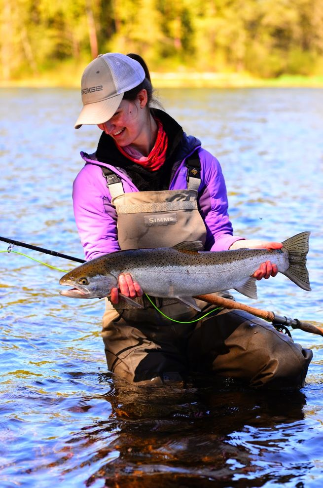 Rogue Angels: Tracy Pennell lands a beautiful steelhead swinging flies. (Tracy Pennell photo)