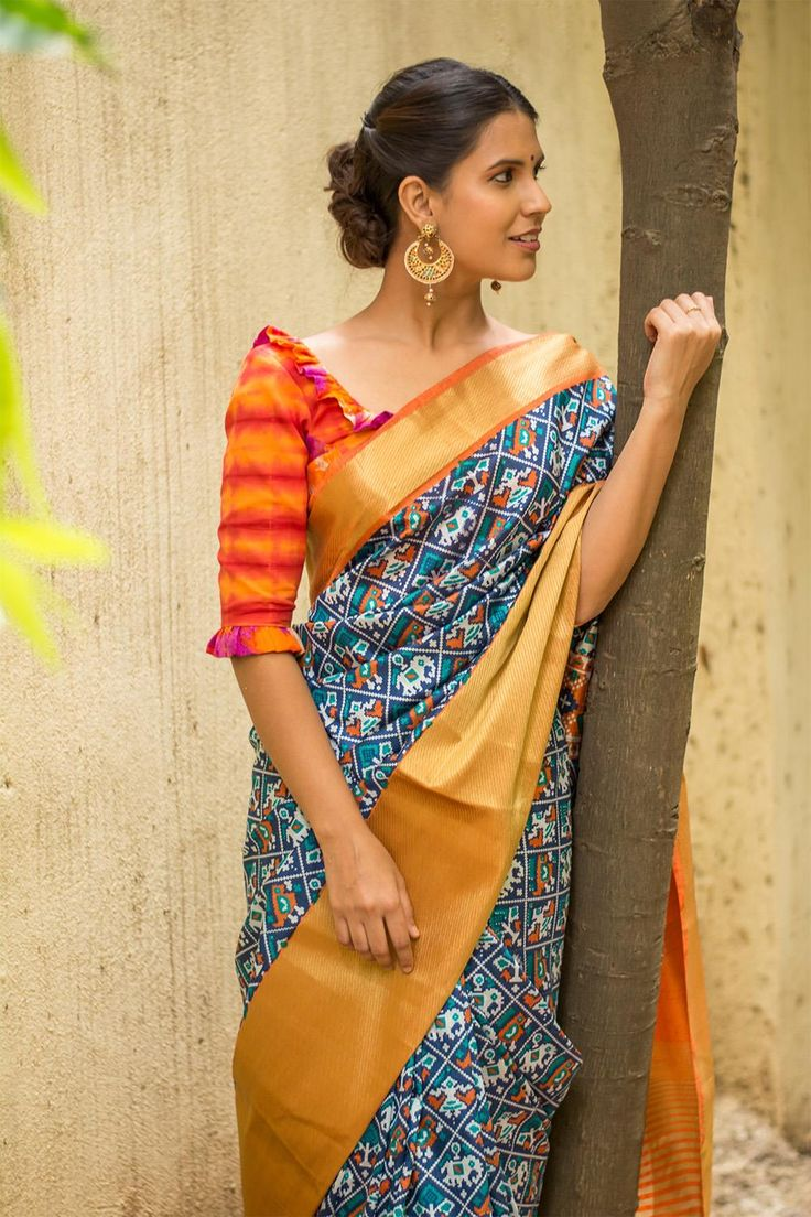 Indigo and orange Patola inspired semi silk saree with a rich tissue border #saree #blouse #houseofblouse #indian #bollywood #style #indigo #orange #gold #tissue #border #patola #inspired #ikat #multicolour