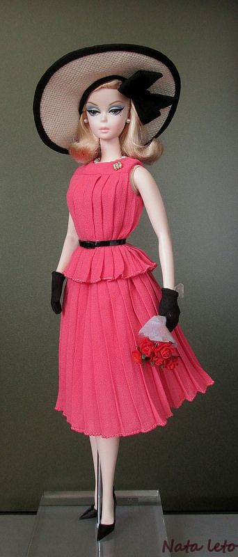 Silkstone Barbie in a magnificent flowing coral, two piece sleeveless dress... with a great straw hat trimmed in black.. and black gloves...