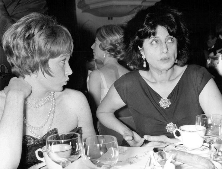 Shirley MacLaine and Anna Magnani share a table at the Lido nightclub in Paris. January, 1962