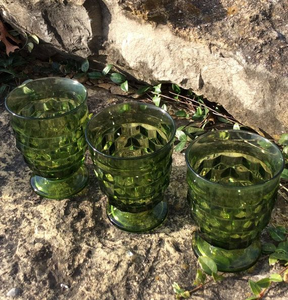 This is a set of three , green Indiana glass drinkware. I used as candle decor on table wth tea lights inside, beautiful holiday decor item! They are a heavy glass with a prism design. Goes with traditional & mid century decor. All three are clean & in good vintage condition.