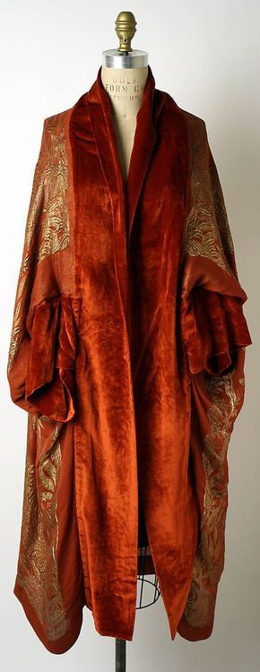 Vintage orange velvet wizard's robes embroidered with gold thread. (The '70s affected the wizarding world, too.)