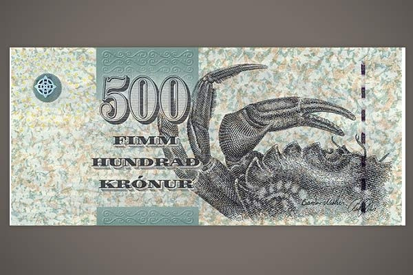 """Faroe Islands (Kronurs)    """"Okay, maybe it's not that beautiful, although the asymmetrical design and the somehow come-hither claws are pretty fetching. But the Faroe Islands, in the far North Atlantic about halfway between Iceland and Norway, have a bleak windswept beauty, and the people have great character. You gotta love a place that puts a crab on its money."""""""