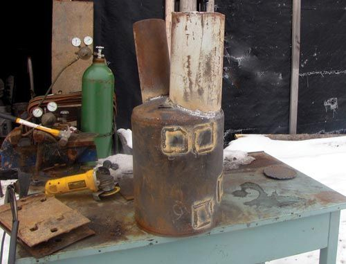 Build a wood-fired stock tank heater by Jackie Clay-Atkinson