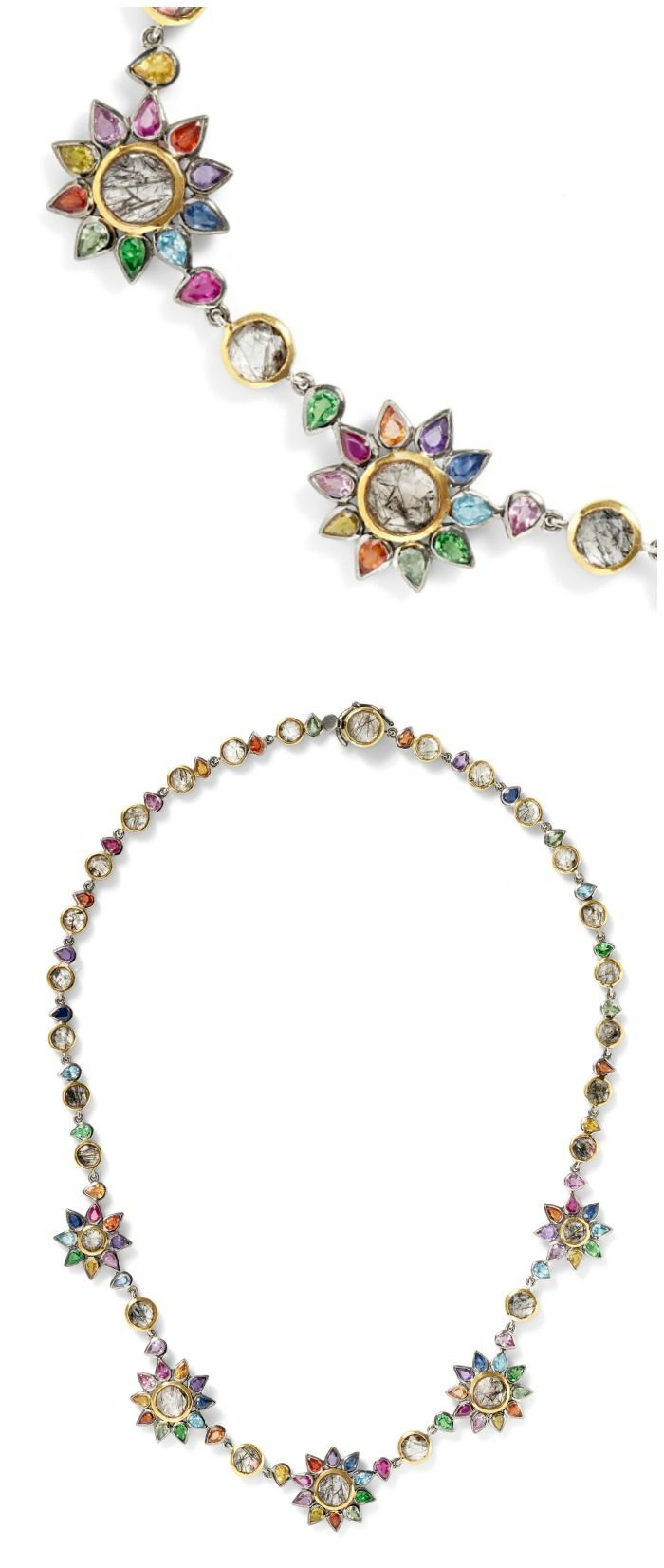 The beautiful Daisy Chain necklace by SheBee, with brightly colored sapphires an...