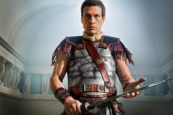 """CRASSUS Simon Merrells A man of great wealth, position and considerable wisdom for his age, Marcus Crassus is the last hope the Roman Senate has to defeat the rebellion. He amassed his extraordinary wealth through a series of shrewd business decisions but the honor of military success has eluded him. Now, Crassus has opportunity to gain that recognition using all means at his disposal to defeat Spartacus. Unlike his predecessors, Crassus will not underestimate this """"mere slave."""" Spartacus…"""