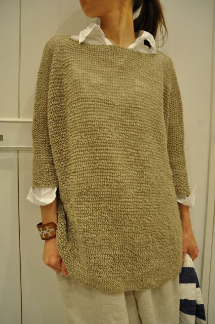 (daniela gregis) loose knit sweater over rumpled linen shirt and bag skirt: casual dowdy-chic idea.