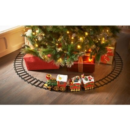 All aboard the North Pole Musical Express! Take a magical ride on this fun toy train which moves around the track while music plays. LED light up train