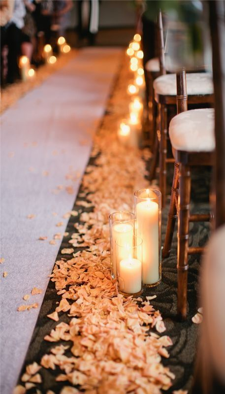 (battery operated) candles with rose petals for ceremony. I think this is how I want the aisle to look.