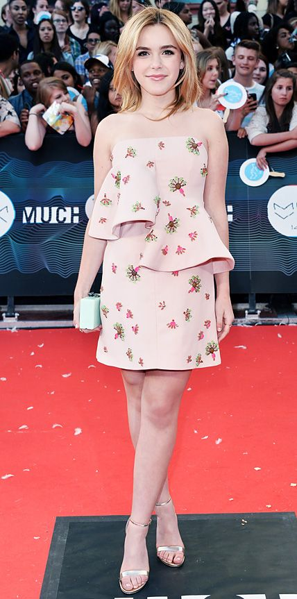 Kiernan Shipka hit the 2014 Much Music Video Awards in a pink wool strapless peplum Marni dress with jeweled embellishments that she styled with a mint green box clutch and metallic Aldo sandals.