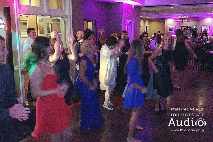 Dancing in the Grand Ballroom at Arrowhead Golf Club. Music, dance floor lighting and elegant #ChicagoUplighting by Fourth Estate Audio. http://www.discjockey.org/lighting-uplighting-options/