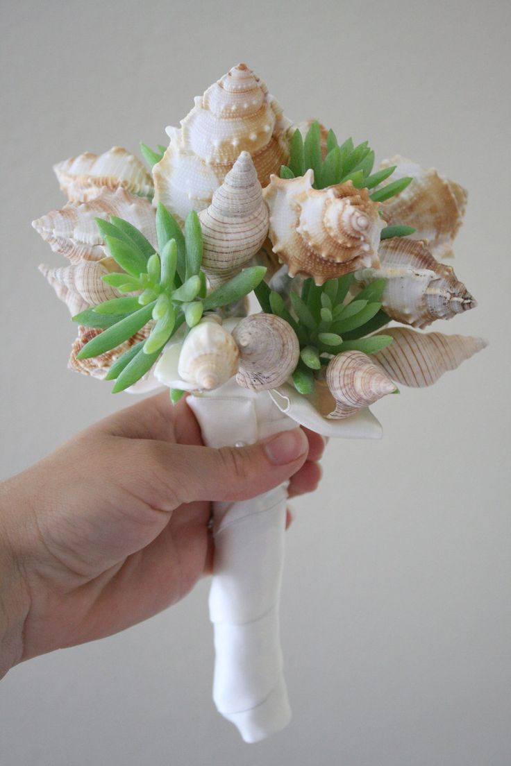 This has sold, but what a lovely idea...SHELL and Succulents. beach wedding bouquet and boutonniere set. $150.00, via Etsy.