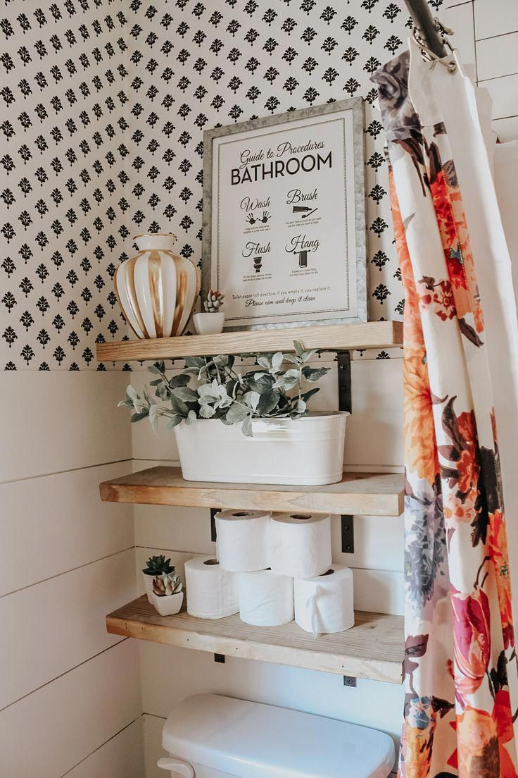 Chic bathroom with open wood shelving above toilet that can be used as storage a…   – bathroom storage