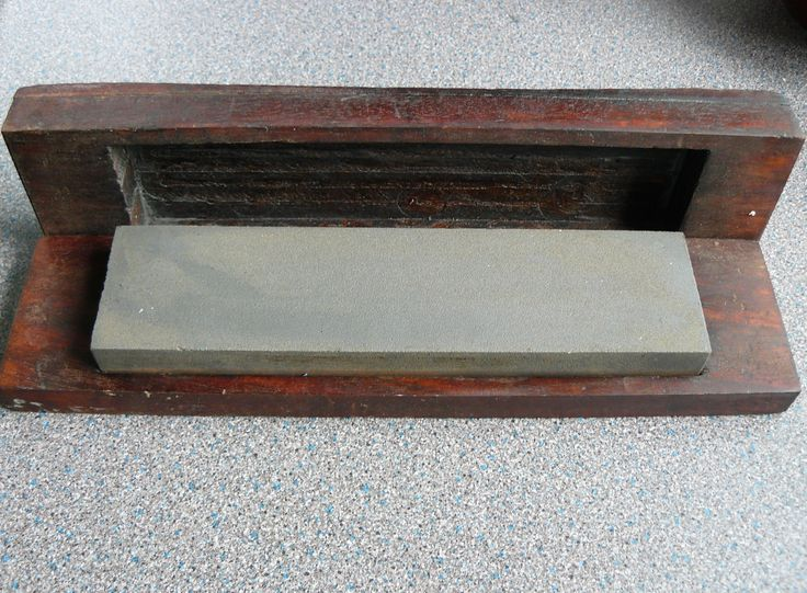 This vintage whetstone, housed in mahogany coloured wood, and sealed with danish oil, would make a unique and useful addition to any kitchen or home.   The wooden case is rustic, with original tool marks and imprints from its years of use.   The whetstone can be used to sharpen kitchen knives, or workshop tools.  The wooden casing measures approximately 28cm x 7cm x 4cm The whetstone measures approximately 20.5cm x 5cm x 2.5cm