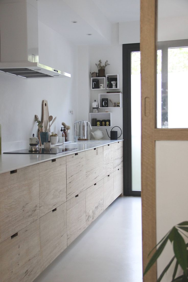 Ikea components are put to stylish use in a Scandinavian-style galley kitchen remodel belonging to designer blogger Ilaria Fatone in the South of France.