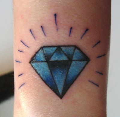 Blue traditional diamond tattoo, done on the back of my wrist by Eric Adkins of High Street Tattoo.