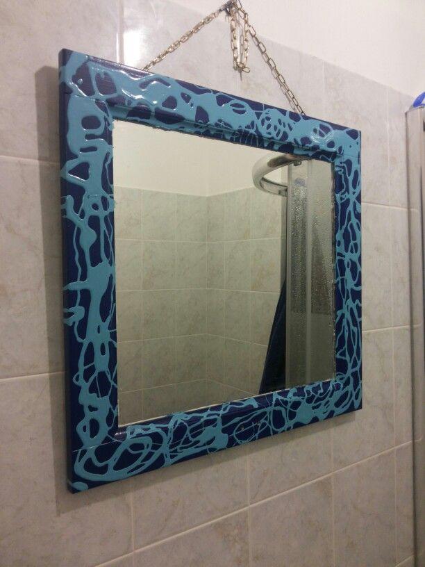 Specchio con vernice colata