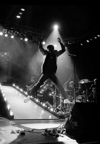 Shakin' Stevens performs on stage jumping from a ramp in April 1983 in Copenhagen Denmark