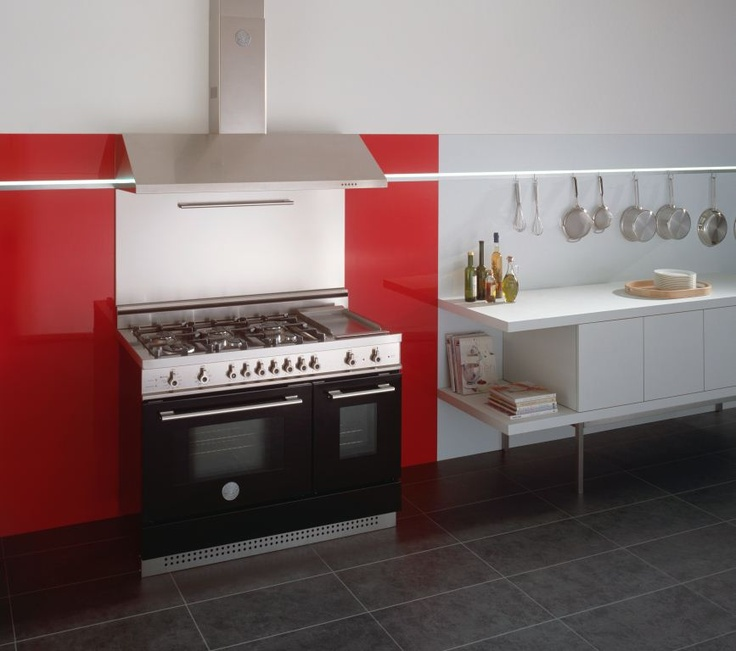 We Think This Black Bertazzoni Professional Series Range Cooker Looks Great  Set Against A Splash Of Red In This White Kitchen.