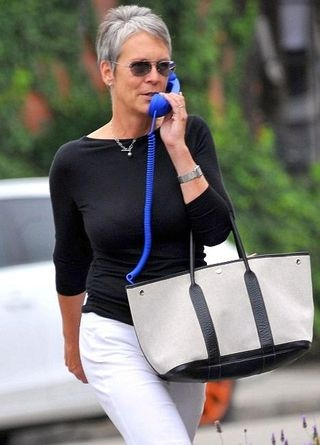 Is it the bag, or her uber cool smile? Whatever, jamie Lee Curtis manages to pull off her look despite the big blue phone!
