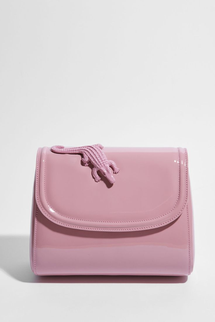 Patent pink cow leather handbag.
