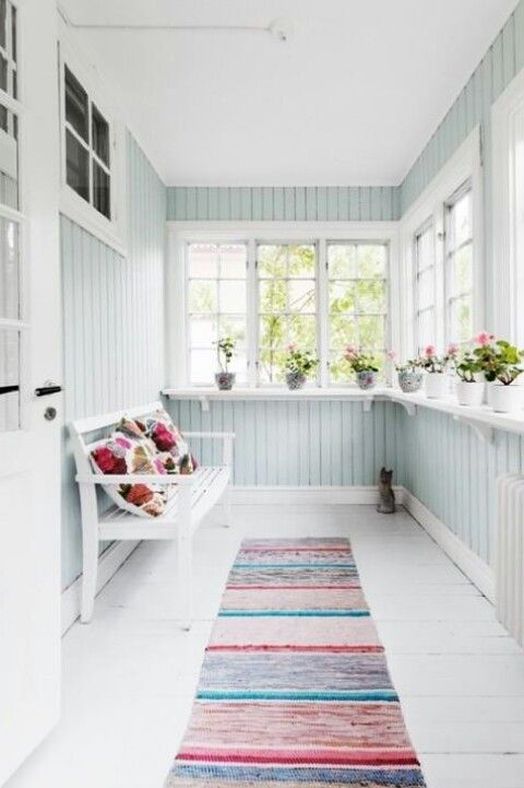 ST: love the idea of adding some shelves to the base of the windows for plants:) And holiday decor. ~~~ Bead board walls in an enclosed porch.  Like the window ledge and flower pots.