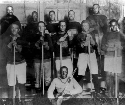 """Players from the Colored Hockey League of the Maritimes (CHL) (c.1900). The CHL was composed of approximately 400 players, primarily Baptist ministers and church laymen, who were comparable to any of the contemporary players in Canada. They defied the stereotypical myths that oppressed them and molded the game of Hockey into the stark competitive sport it is today. Eddie Martin, a player from the league, is credited as being the grandfather of the """"slap shot"""" that every player uses today."""