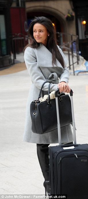 Angelic in dove grey: Michelle Keegan is chic in a wraparound coat as she meets fiance Mark Wright for a Glasgow date