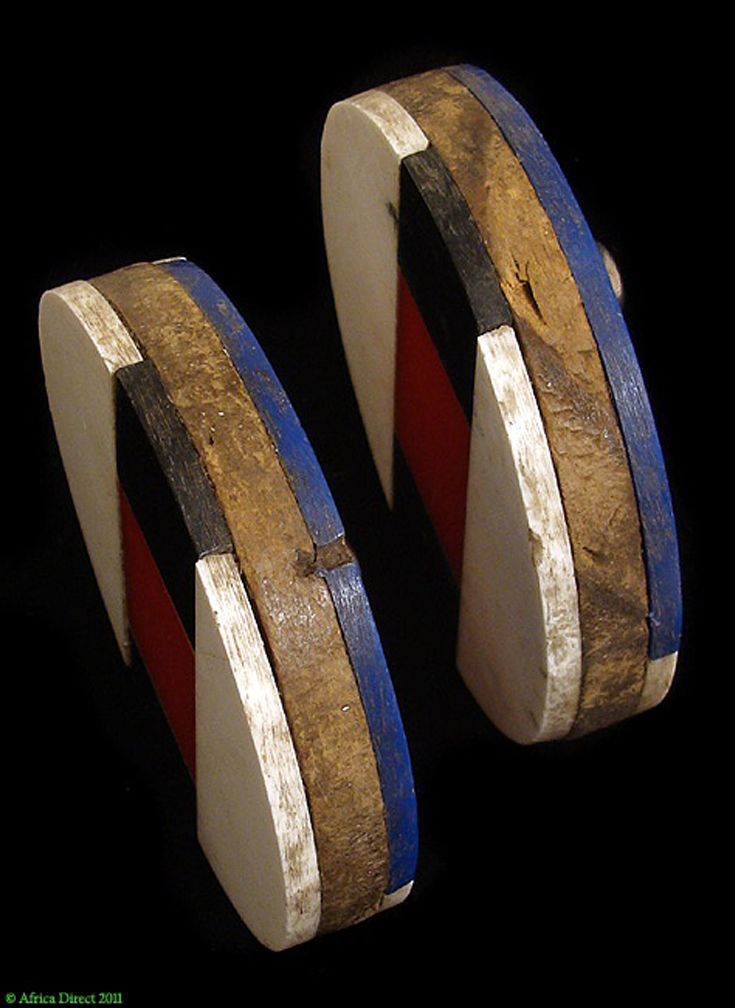 Africa | Detail from a pair of old Earplugs ~ Isizhaza Amashaza ~ from the Zulu people of South Africa | Marlet titles, wood and glue | ca. 1950s