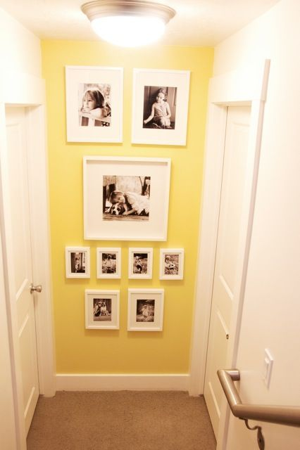 Pictures at the bottom of the stairs. Love it! I've been looking for a great idea like this.