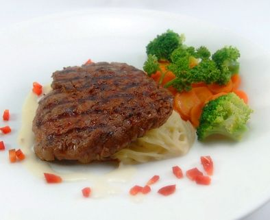 TOURNEDOS ANGEL HAIR. Available in local, Aust & Black Angus tenderloin beef. Served with angel-hair pasta, broccoli & vichy carrot, in creamy mushroom sauce.