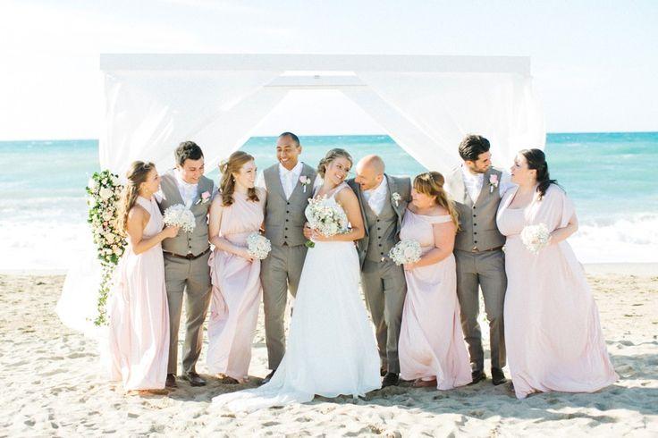 Intimate group portrait beside the sea after romantic beach wedding ceremony in Crete. MOMENTS www.weddingincrete.com