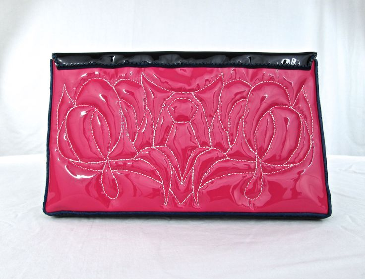 Hand crafted and hand stitched quilted patent leather clutch bag...  Worm Eats Bird may be 'Addicted...' www.wormeats.com    Thank you  :  )