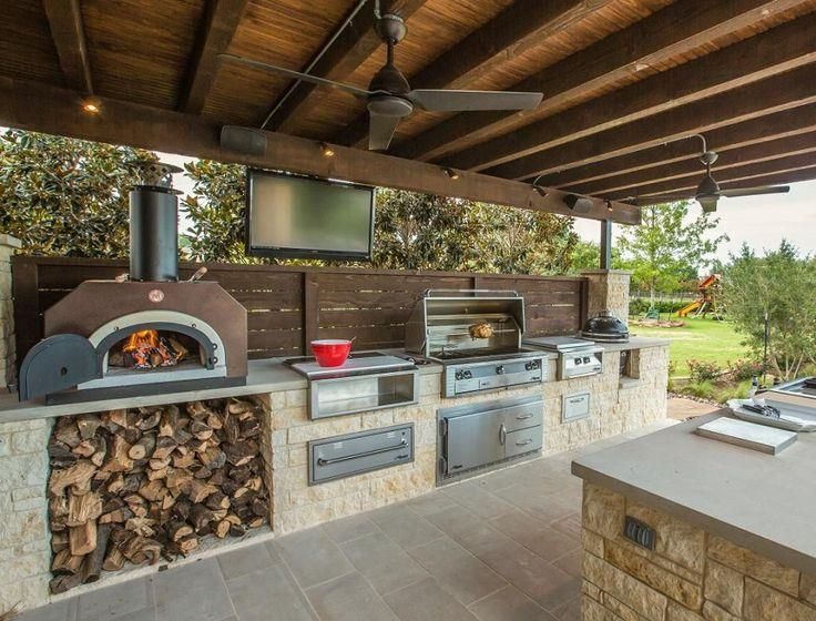 Backyard Lamp Post With Bar Stool Also Counter Top Wood Burning Oven And Flood Light Besides Bbq Cover  Storage Box  Hardwood Lump Charcoal     Backyard with an Outdoor Kitchen Mediterranean Style for Modern House