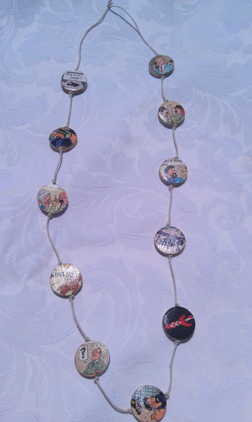 Tin Tin necklace.  Comic book paper, wooden beads, lacquer, hemp string. $15