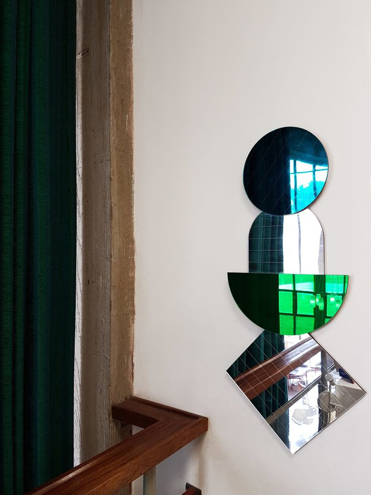 LAYER MIRRORS IN TEAL & EMERALD GREEN Layer Mirrors looking particuarly oppulent next to the long emerald green curtains and concrete detailing. The four separate mirrors have been hung over each other to create a stacking display. SHOP