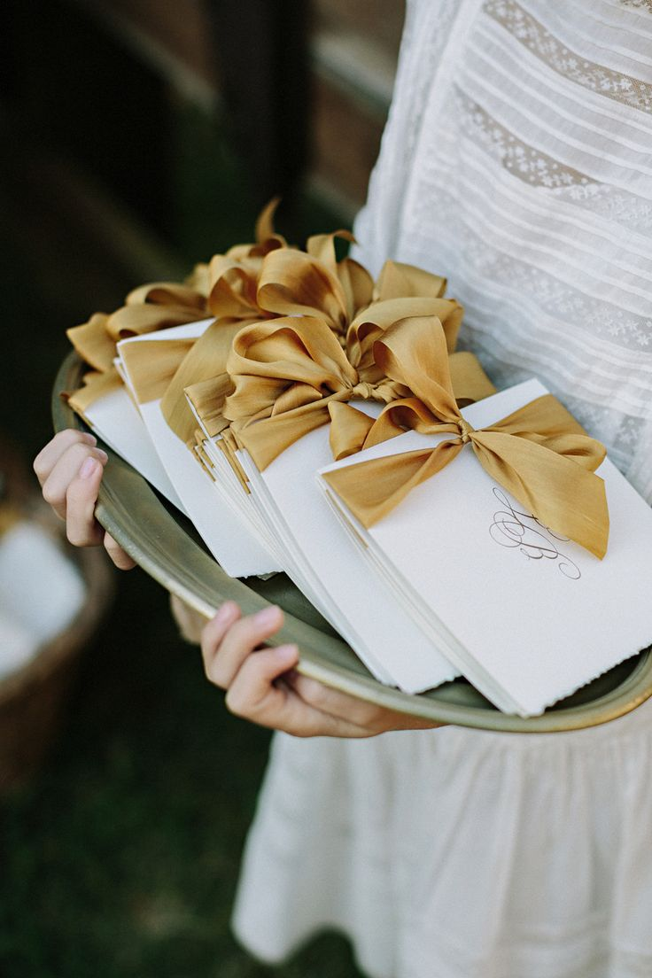 Wedding programs bound with gold ribbon | Photography: Jonas Seaman Photography - jonas-seaman.com  Read More: http://www.stylemepretty.com/2014/06/16/autumn-wedding-with-shades-of-gold/
