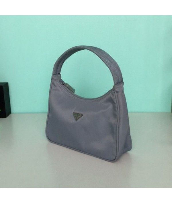 b7d5a568abc4a2 Prada Pervinca Vela Mini Baby Blue Nylon Baguette - New Women's Bag -  Baguettes