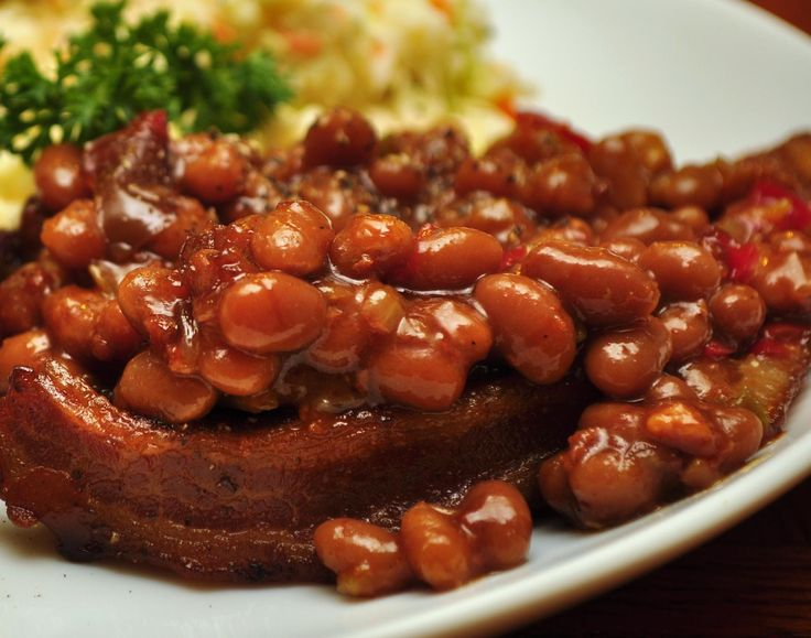 Baked Beans Ingredients 3 - 28 oz cans of Bush's baked beans (or Van De Camp pork and beans) 1/4 - 1/2 cup molasses 1/4 - 1/2 brown sugar 4-6 slices of mostly cooked bacon, chopped into pieces 1 medium onion, diced (and sauteed in bacon drippings) DirectionsIn a 3 quart casserole dish (I like using a heavy crock for even cooking), mix all the ingredients. Bake in a 350 oven with a cover for 1 to 1.5 hours. Then, remove the cover, stir and bake for another 1 hour.