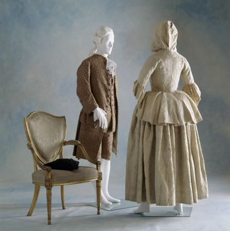 View of a man's silk velvet suit, c1760s, with matching waistcoat & breeches, & a hooded lady's travelling satin quilted jacket & skirt c1745-60 at Berrington Hall, Herefordshire.