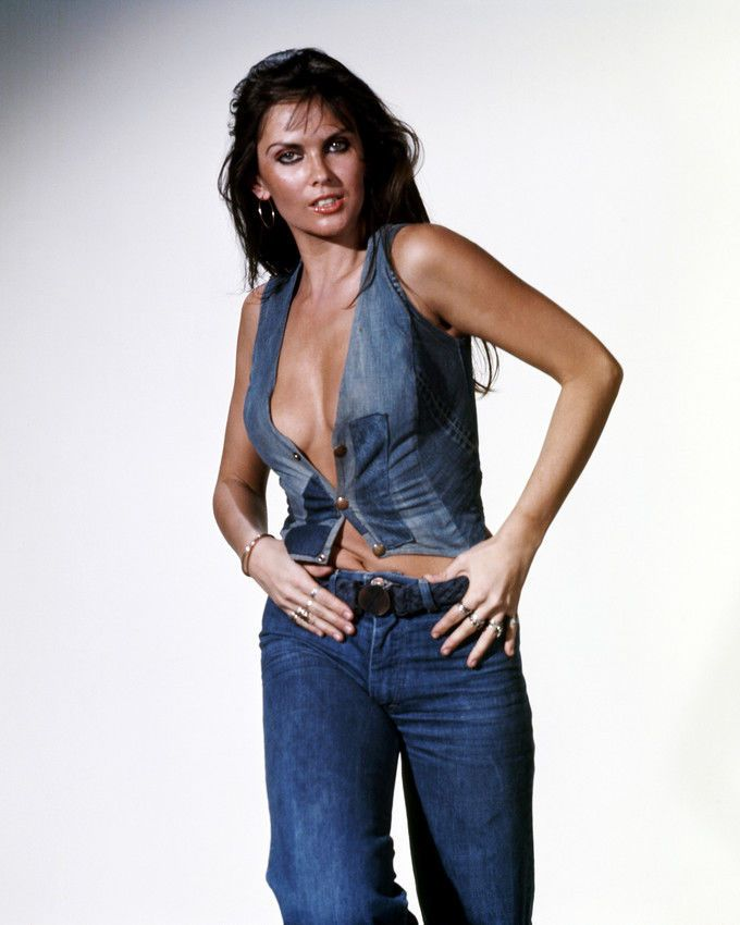 CAROLINE MUNRO SEXY IN OPEN DENIM WAISTCOAT AND JEANS PHOTO OR POSTER
