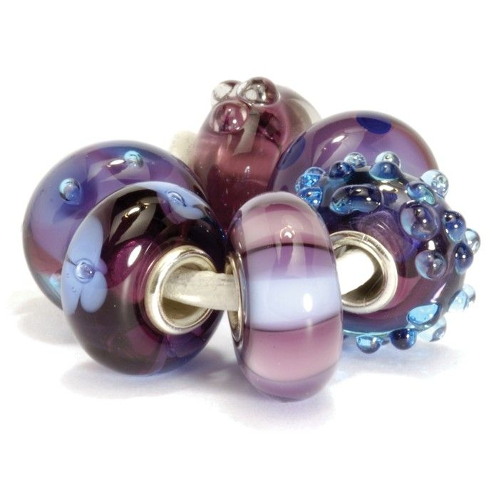 Pensive, twilight hues of purple evoke imagery of clouds at sunset. Beads included in this kit: Purple Flower Bud, Purple Dot, Blue Fizz, Purple Stripes, Purple Flower and Purple Bubbles.