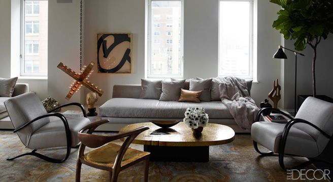 Ivanka Trump and Jared Kushner's apartment. In the living room of the apartment, which was designed by Kelly Behun, a custom-made sofa upholstered in an Élitis velvet and vintage Jindřich Halabala armchairs surround a 1970s cocktail table by Fernand Dresse; the light fixture is by Downtown, the drawing is by Jan Yoors, and the custom-made rug is by ABC Carpet  Home.