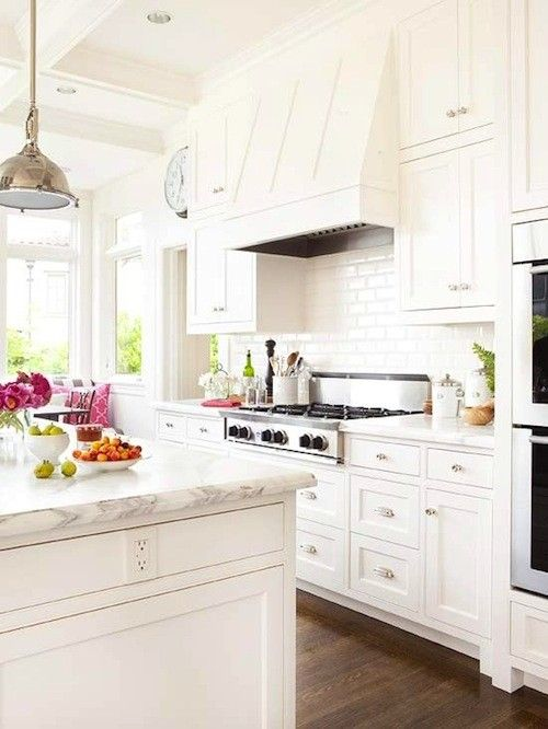 Another beautiful example of the white cabinets,