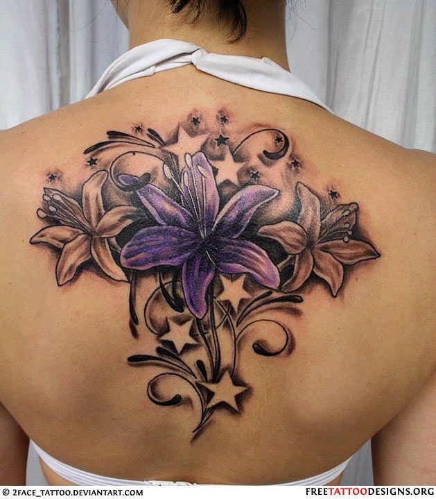 Woman with a flower and stars tattoo on her back