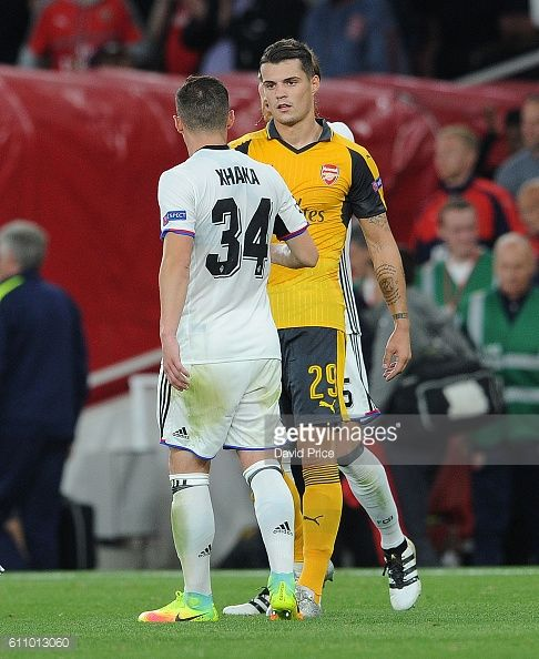 Granit Xhaka of Arsenal shakes hands with his brother Taulant Xhaka of Basel after the UEFA Champions League match between Arsenal FC and FC Basel...