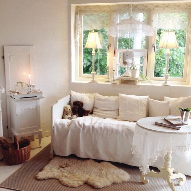 my beautiful shabby chic white and romantic daybed, in my livingroom