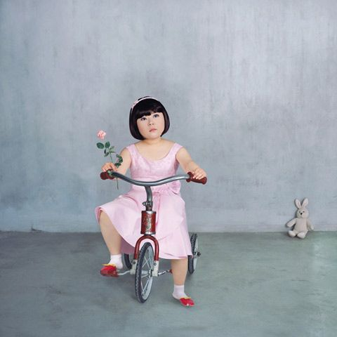 """Interesting series by Yu_Xiao """"Never grow up"""" as a commentary on the Chinese one child rule and the intens focus on childhood that comes with it."""